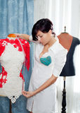 Dressmaker with mannequin working at home Stock Images