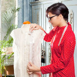 Dressmaker with mannequin working at home Royalty Free Stock Photography