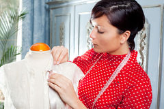 Dressmaker with mannequin working at home Stock Photos