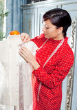 Dressmaker with mannequin working at home Royalty Free Stock Photo