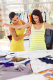 Dressmaker measuring client Stock Photos