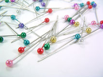 Dressmaker Pins. Ball head dressmaker pins on white Royalty Free Stock Images