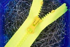 Dressmaker pins background with yellow zip Royalty Free Stock Photography