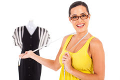 Dressmaker presenting Royalty Free Stock Image