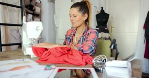 Dressmaker in process of working stock footage