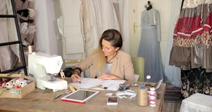 Dressmaker in process of working stock video footage