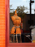 Dressmaker's Form In Window Royalty Free Stock Image