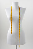 Dressmaker's mannequin. With tape measure on white background Stock Image