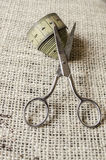 Dressmaker scissors and meter tape Stock Photo