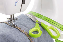 Dressmaker scissors, sewing machine and meter. Textile . Stock Photos