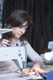 Dressmaker sewing the pattern Stock Photo