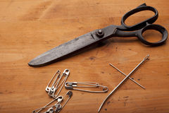 Dressmaker shears with tailor tools and needles craft concept on Royalty Free Stock Photos