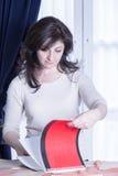 Dressmaker with sketchbook Stock Photography