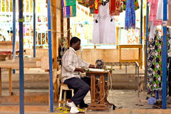 Dressmaker. A dressmaker in Sucupira Market in Praia in the island of Santiago in the archipelago of Cape Verde stock images