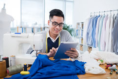 Dressmaker with tablet Stock Photography