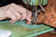 Dressmaker weaving a cushion Royalty Free Stock Photography