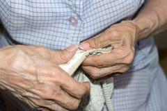 Dressmaker weaving a cushion. Details of a dressmaker weaving a cushion royalty free stock image