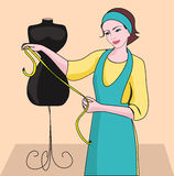 Dressmaker. Woman seamstress and dressmaker to try tailoring model and clothing Stock Photo