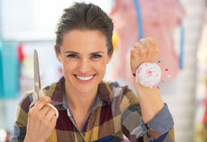 Dressmaker woman showing scissors and pincushion Stock Photos