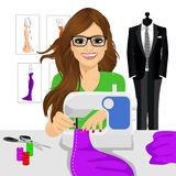 Dressmaker woman using sewing machine Stock Photo