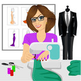 Dressmaker woman using sewing machine Stock Photo