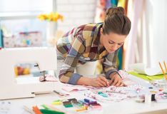 Dressmaker woman at work in studio Royalty Free Stock Photography
