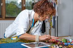Dressmaker work with  a digital tablet Royalty Free Stock Photo