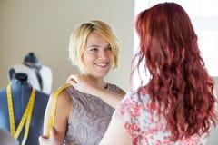 Dressmaker at work Stock Photos