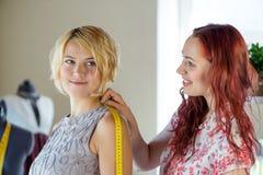 Dressmaker at work Stock Images