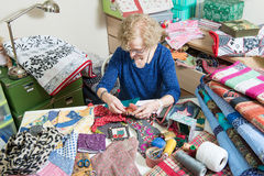Dressmaker working on her patchwork Royalty Free Stock Image