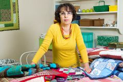Dressmaker working on her patchwork Stock Photography
