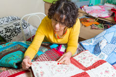 Dressmaker working on her patchwork Royalty Free Stock Photo