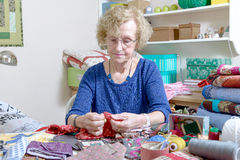 Dressmaker working on her quilt Royalty Free Stock Images