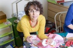 Dressmaker working on her quilt Stock Image