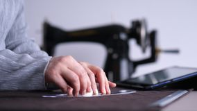 The dressmaker works on the table. stock footage
