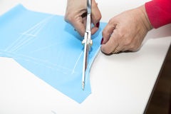 Dressmakers cutting fabric Royalty Free Stock Photos
