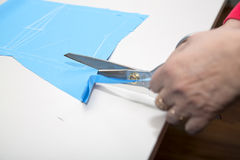 Dressmakers cutting fabric Stock Photography