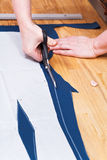 Dressmaking clothes according with pattern Stock Photos