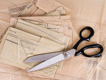 Dressmaking pattern and scissors, background Stock Photos