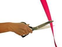 Dressmaking scissors cutting red tape- isolated Royalty Free Stock Photography