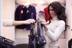 In dressroom. Woman in dress room wear dress Royalty Free Stock Image