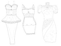 Dresssketches of stylish women's dresses pencil Royalty Free Stock Photo
