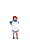 Dressup as a Rag Doll. Old fashioned costume depicts little girl as a rag doll.  She gives a quirky smile and wears apron and striped socks with style. Her hair Stock Images
