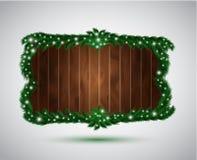 Drewniana deska z jedlinowymi gałąź Obraz Stock