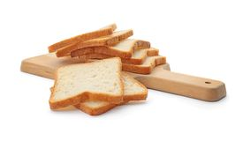 Drewniana deska z pokrojonym grzanka chlebem Zdjęcia Stock