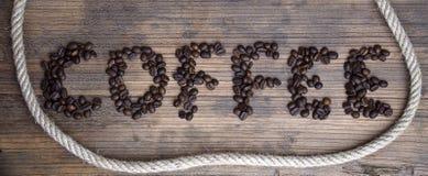 Drewniana deska z słowo kawą Fotografia Royalty Free