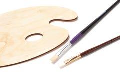 Drewniana farby paleta, muśnięcia i Fotografia Stock