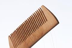 Drewniana grępla z ciemnego włosy pasemkami Obraz Royalty Free