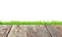 Drewniana podłoga, zielona trawa nad bielem Obrazy Royalty Free