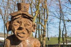 Drewniana postać rzeźbiąca z łańcuszkowym saw Zdjęcie Royalty Free